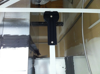 Plumbing a vertical soffit tee with the Cross-T-Squared tool.